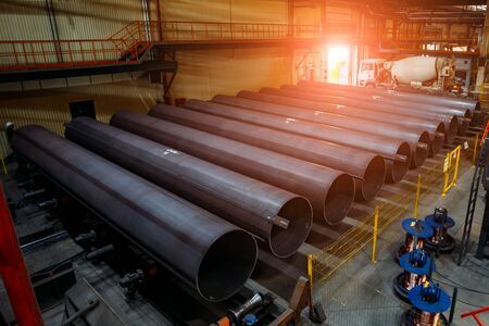Steel pipes for water or gas pipeline construction in warehouse.