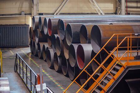 Black steel pipes for water or gas pipeline construction in warehouse