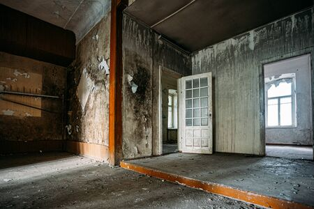 Abandoned house interior, dirty room, rotten walls.