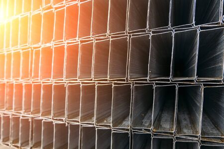 Bent metal profile channel package, abstract background Stock Photo