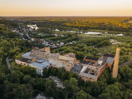 Ruined overgrown abandoned sugar factory in Ramon, aerial view, 스톡 콘텐츠