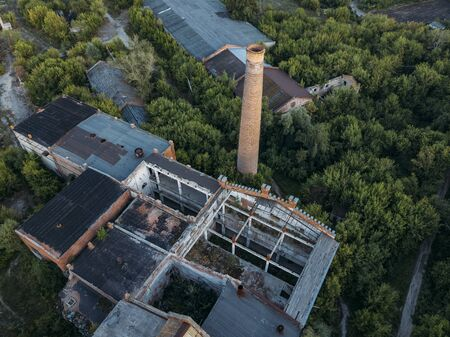 Ruined overgrown abandoned sugar factory in Ramon, aerial view 스톡 콘텐츠