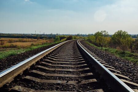 Empty railway track in sunny summer day 写真素材