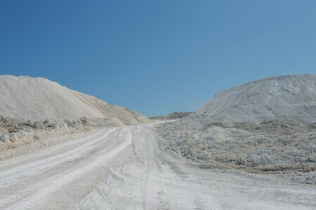 Open chalk mining quarry in sunny day