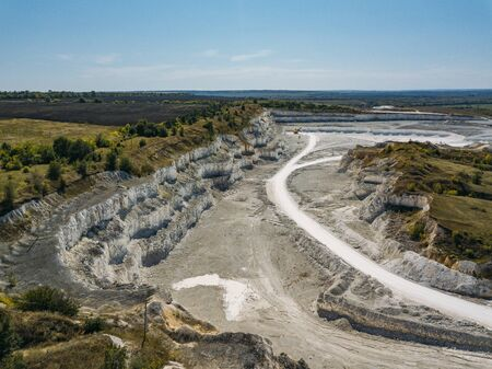 Open chalky quarry, aerial view from drone