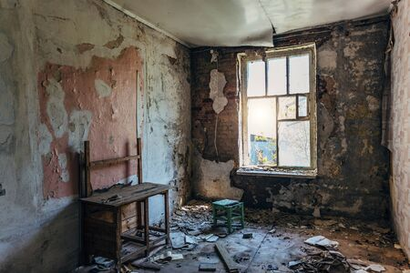 Interior of messy room at old abandoned building