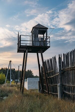 Old observation tower in abandoned Soviet Russian prison complex. Stok Fotoğraf