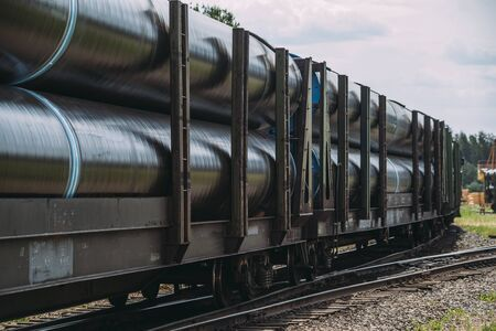 Freight train with new manufactured pipes selective focus.