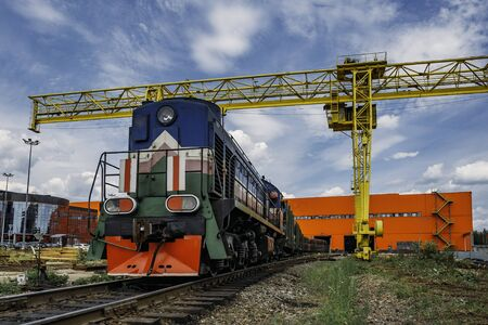 Freight train with cargo exits from warehouse. Stok Fotoğraf