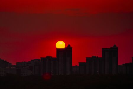 Sunset over high modern urban buildings in Voronezh.