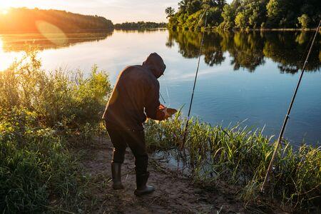 Fisherman caught big fish carp in the morning.