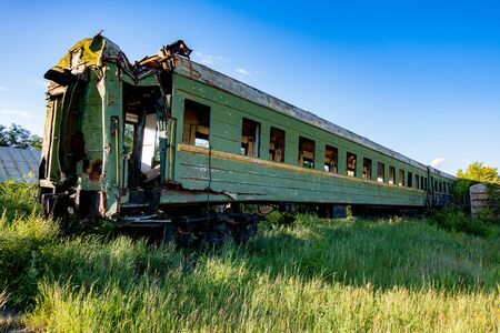 Abandoned train. Forgotten overgrown railway. Old rusty railway carriage. Stok Fotoğraf - 130126935