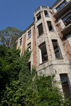 Overgrown ruins of abandoned palace of Smetskoy (Sanatorium named after Lenin), Abkhazia. Green post-apocalyptic concept.