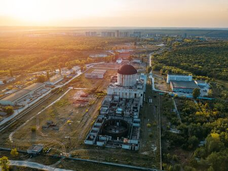 Abandoned and ruined unfinished Nuclear Power Plant for heat supply in Voronezh, aerial top view from drone Stok Fotoğraf - 130126996