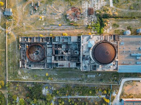 Abandoned and ruined unfinished Nuclear Power Plant for heat supply in Voronezh, aerial top view from drone.