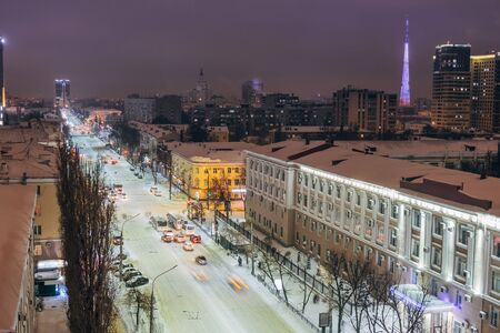 Night Voronezh downtown in winter, aerial summer cityscape from rooftop.