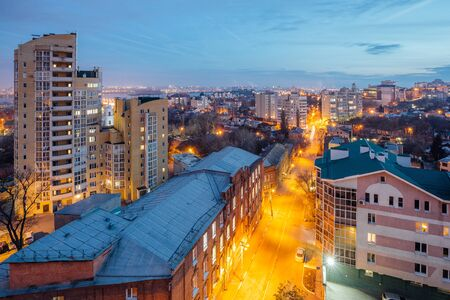 Aerial view of night Voronezh downtown. Voronezh cityscape at blue hour. Urban and traffic lights, houses.