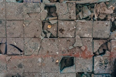 Shards of broken glass block panel on dirty floor. Stok Fotoğraf - 130126954