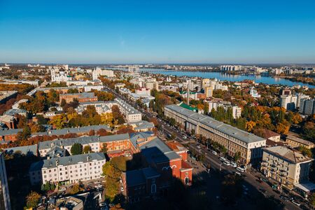 Sunny golden autumn Voronezh. Aerial view from skyscraper roof height to Revolution prospect - central street of Voronezh.