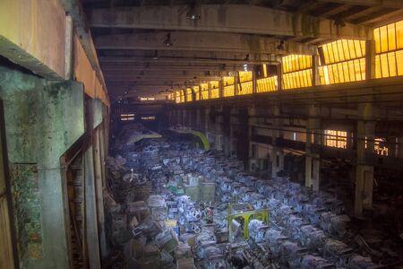 Military warehouse with rusted tank diesel engines, Kharkov, Ukraine. Stok Fotoğraf - 130126914