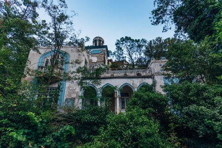 Abandoned and overgrown mansion in oriental style. Concept of Tale 1001 Arabian Nights. Villa Dream, Crimea.