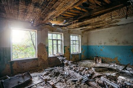 Interior of messy dirty room at old abandoned building. Stok Fotoğraf - 130126850