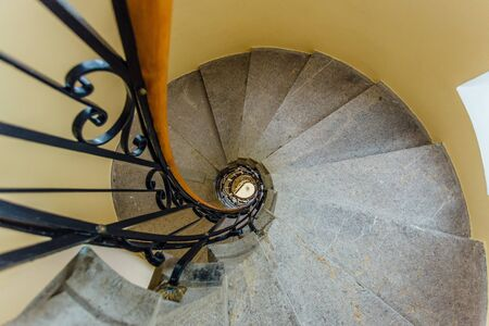 Old spiral metal staircase inside tower, bottom view. Stok Fotoğraf - 130126851