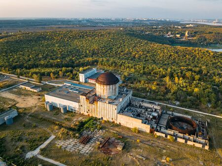 Abandoned and ruined unfinished Nuclear Power Plant for heat supply in Voronezh, aerial top view from drone