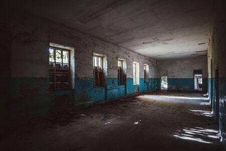 Dark dirty corridor of old abandoned building. Stok Fotoğraf