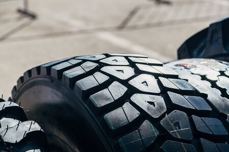 Clean new modern truck tire. Close up view of surface. Banco de Imagens