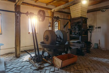 Old oil mill, millstones and and mechanical press. 版權商用圖片