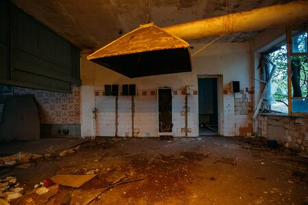 Abandoned and ruined kitchen of closed factory canteen or restaurant. 版權商用圖片