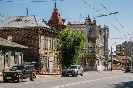 Street cityscape view of Samara. Old houses, modern cars