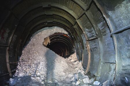 The collapse in the chalk mine, tunnel with metal mine roof supports Stockfoto