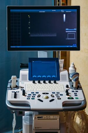 Modern ultrasound machine in clinic laboratory of sonography diagnostics.