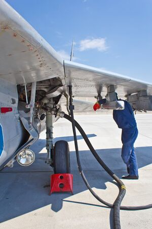 Refueling of military aircraft in airport. Preparations for flight.