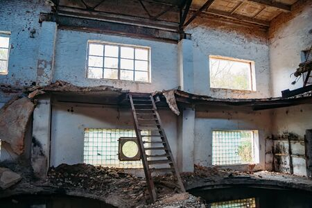 Old abandoned and ruined red brick building interior of former sugar factory in Ramon, Voronezh region