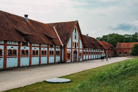 Old horse stables in courtyard of old German manor. Stok Fotoğraf