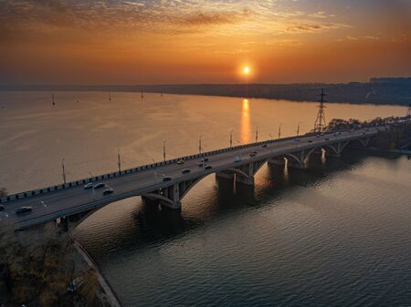 Evening autumn Voronezh. Sunset above Vogresovsky bridge over Voronezh river, aerial view