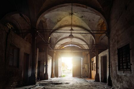 Old abandoned building with vaulted celling in Gothic style.