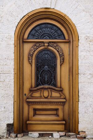 Beautiful ornamental wooden door of old mansion.