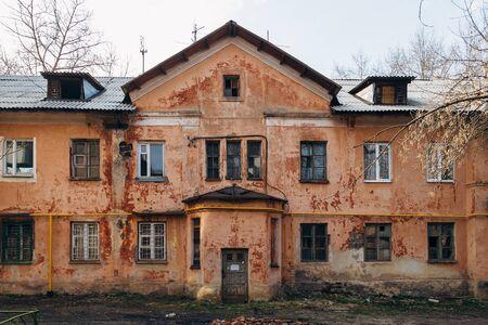 Old poor slum house in Voronezh, poverty concept.