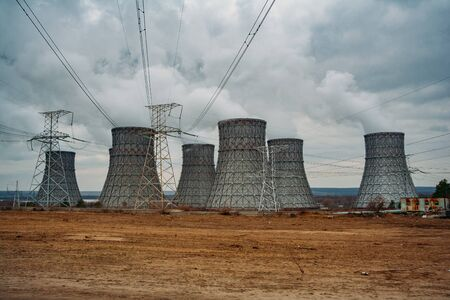 Cooling tower of nuclear power plant and power lines.