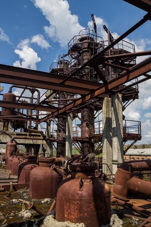 Abandoned ruined chemical plant with remain rusty tanks and pipes.