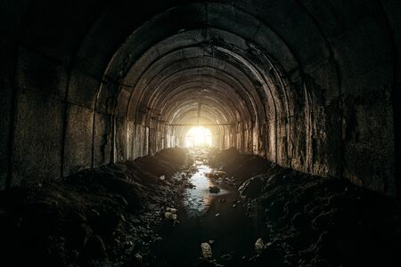 Light at the end of dirty sewer tunnel.