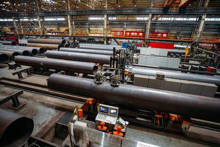 Steel pipe internal seam welding by longitudinal tack welding machine.