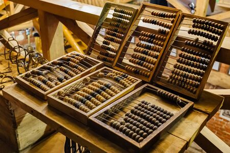 Old vintage wooden abacus on wooden table.
