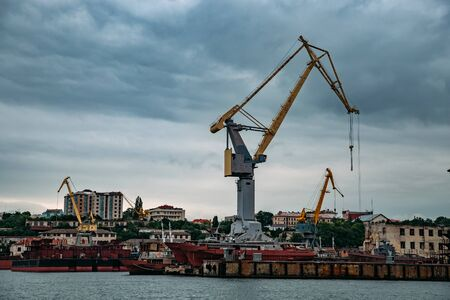 Sea port with cargo cranes and dry dock for ship repair. 版權商用圖片
