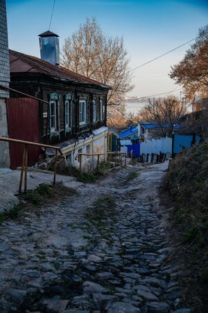 Old houses on low-rise street in old poverty part of Voronezh city in Russia. Stock Photo
