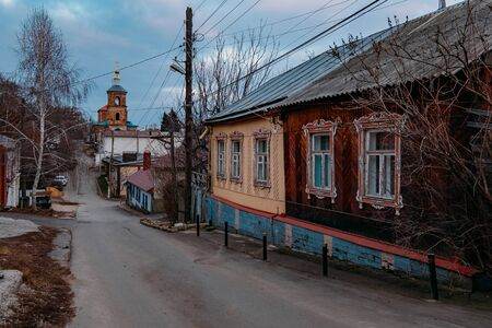 Old houses on low-rise street in old poverty part of Voronezh city in Russia.